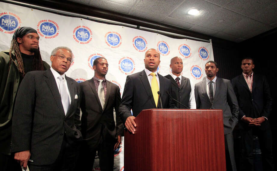 As Derek Fisher, center, president of the NBA players union, speaks during a news conference, Etan Thomas, Billy Hunter, Chris Paul, Maurice Evans, Roger Mason Jr. and James Jones, from left, listen after NBA labor talks ended Thursday, Oct. 20, 2011, in New York. After 30 hours of negotiations over three days, the two sides remained divided over two main issues--the division of revenues and the structure of the salary cap system. (AP Photo/Frank Franklin II) / AP
