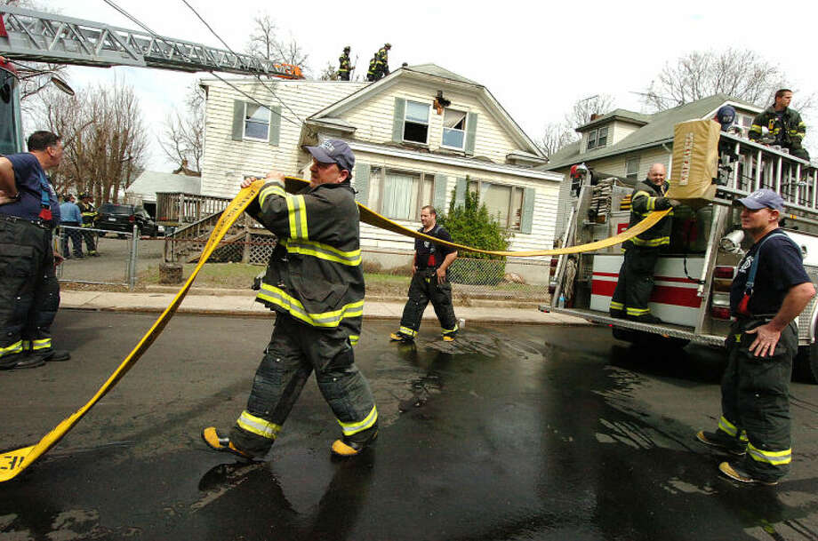 Hour Photo/Alex von Kleydorff Emergency personnel respond to a house fire on Lawrence St. Norwalk Tuesday