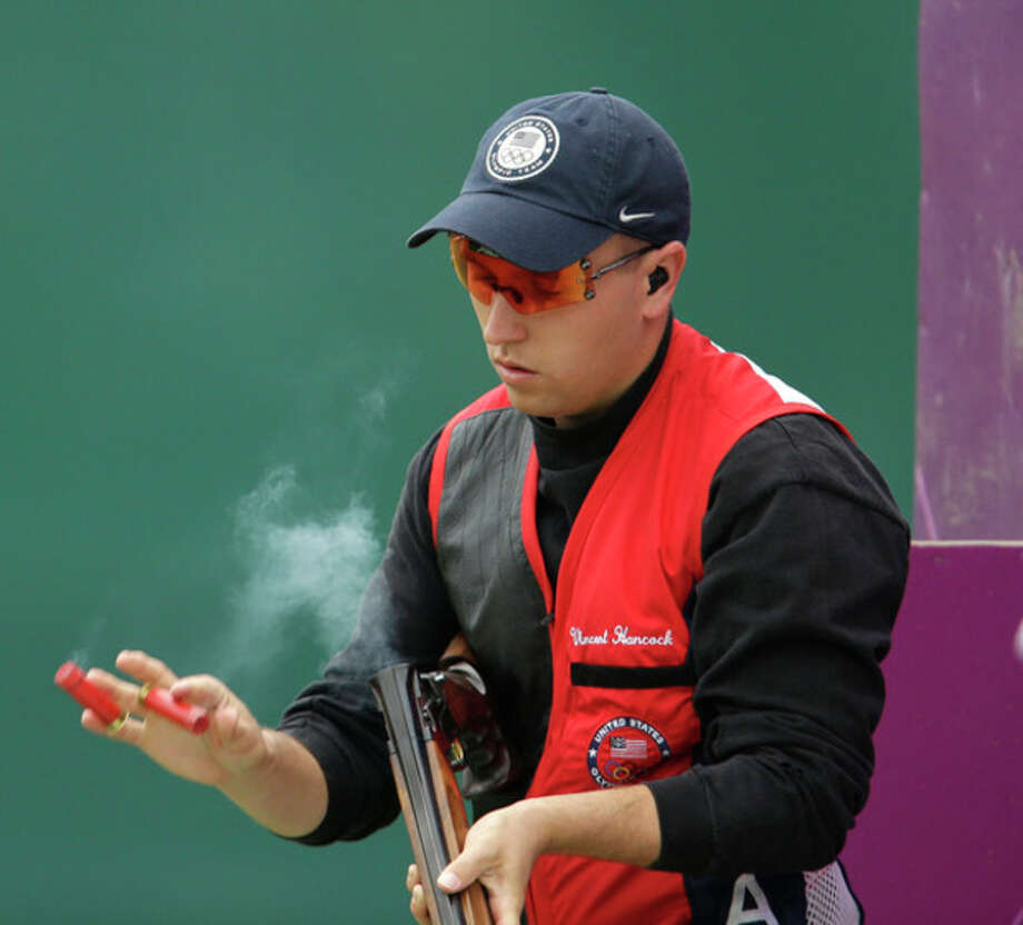 United States of America's Vincent Hancock ejects spent cartridges after shooting, during the second day of qualifiers for the men's skeet event at the 2012 Summer Olympics, Tuesday, July 31, 2012, in London. (AP Photo/Rebecca Blackwell) / AP