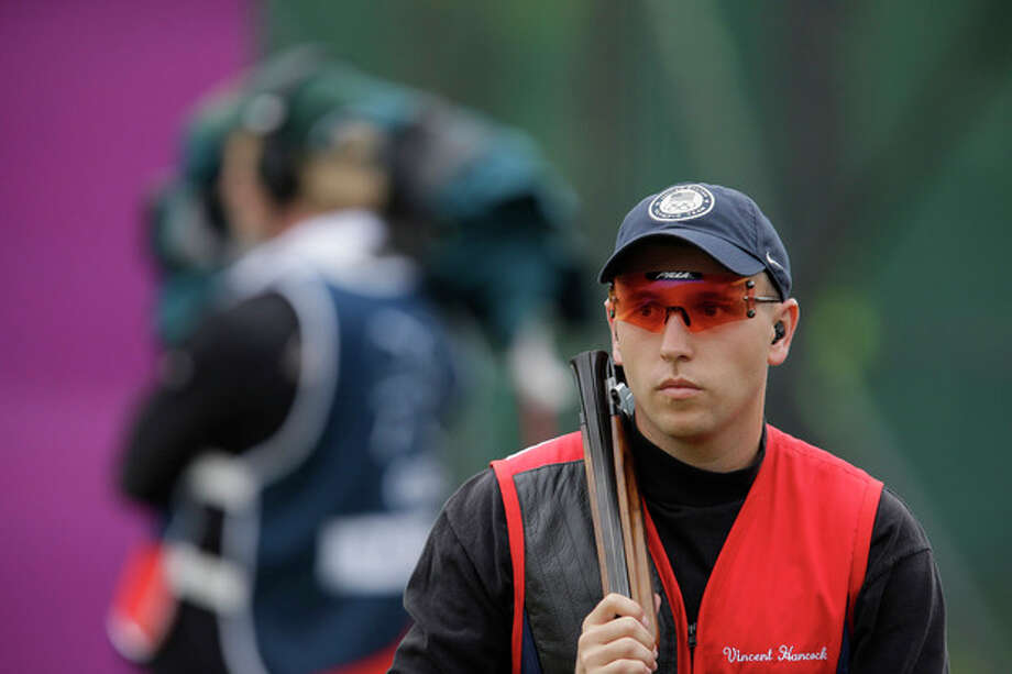 United States of America's Vincent Hancock walks between shots during the second day of qualifiers for the men's skeet event at the 2012 Summer Olympics, Tuesday, July 31, 2012, in London. (AP Photo/Rebecca Blackwell) / AP