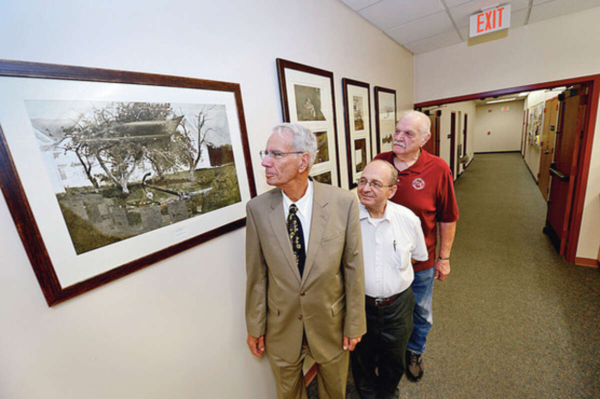 """Wyeth on the wall Art Goldblatt has donated a print of Andrew Wyeth's """"Sea Anchor"""" to the Norwalk Public Library to complete a collection of Wyeth prints obtained through the Friends of the Library book sale and hung by Ralph Bloom and library board member Stan Siegel. Hour photo Erik Trautmann"""