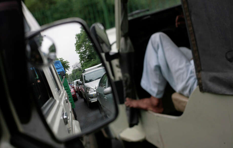 A traffic jam following power outage and rains in New Delhi, India, Tuesday, July 31, 2012. India's energy crisis cascaded over half the country Tuesday when three of its regional grids collapsed, leaving more than 600 million people without government-supplied electricity in one of the world's biggest-ever blackouts. (AP Photo/Altaf Qadri) / AP