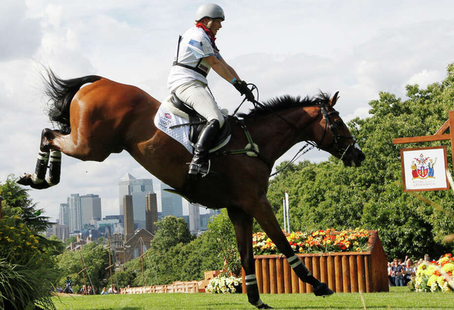 Zara Phillips of Great Britain rides High Kingdom as she competes in the equestrian eventing cross-country stage at the 2012 Summer Olympics, Monday, July 30, 2012, in London. (AP Photo/Ng Han Guan) / AP