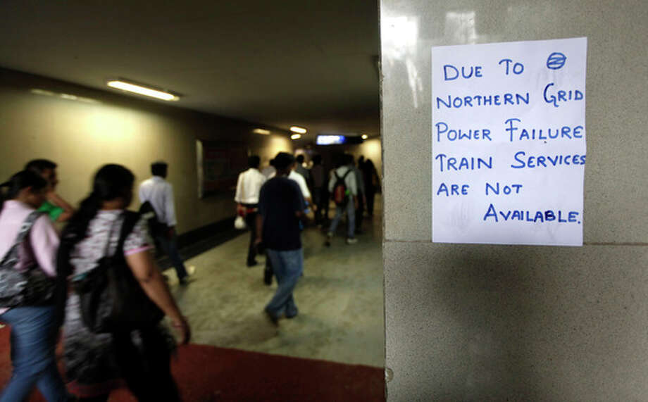 A handwritten notice about power failure is pasted outside a Metro station after Delhi Metro rail services were disrupted following power outage in New Delhi, India, Tuesday, July 31, 2012. India's energy crisis cascaded over half the country Tuesday when three of its regional grids collapsed, leaving more than 600 million people without government-supplied electricity in one of the world's biggest-ever blackouts.(AP Photo/ Manish Swarup) / AP
