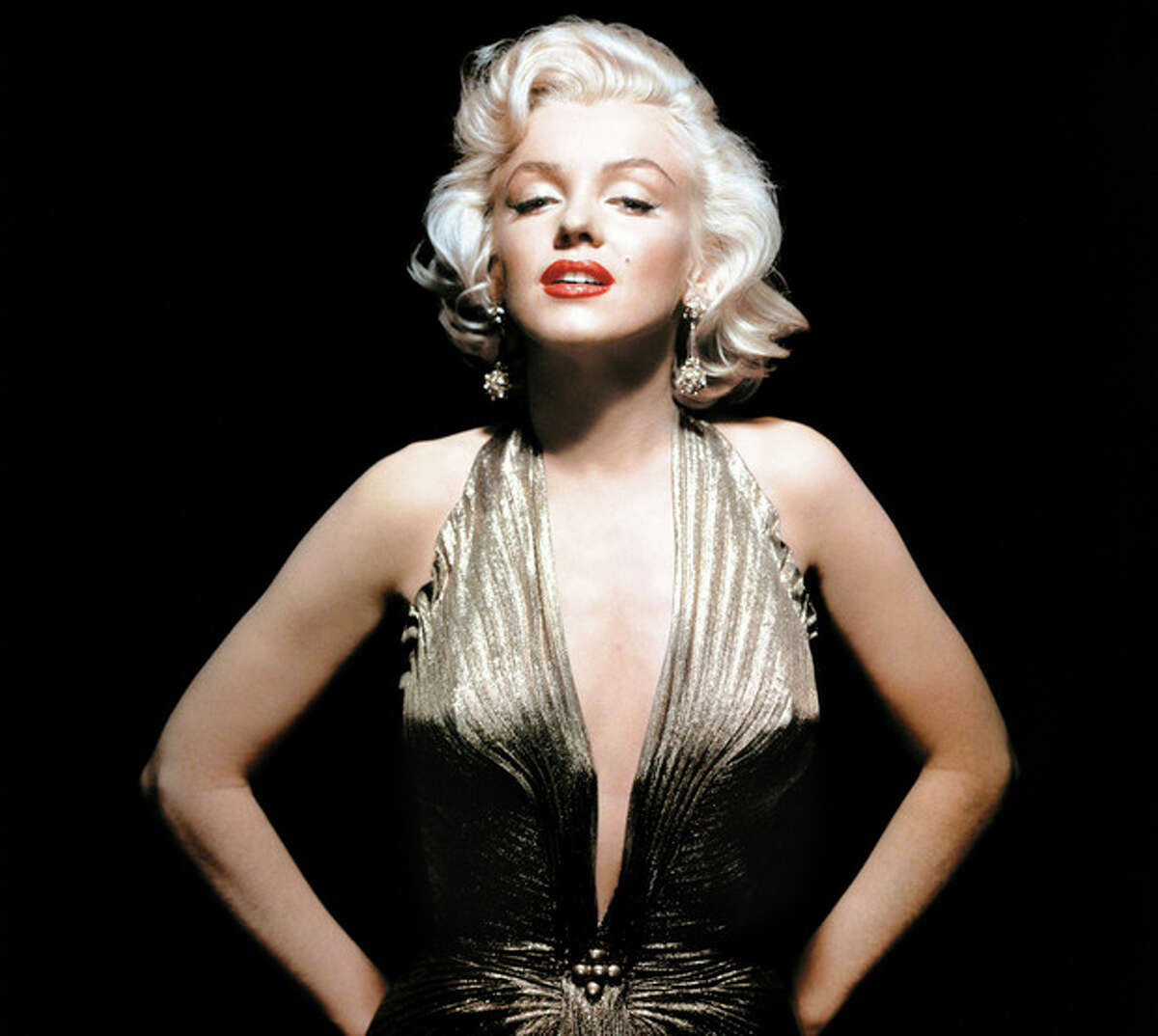 """In this undated publicity photo courtesy Running Press, Marilyn Monroe is shown wearing a knife-pleated gold lamé gown made from ?""""one complete circle of fabric.?"""" She wore this dress in """"Gentlemen Prefer Blondes."""" Monroe passed away a half-century ago this week, a murky death that remains one of Hollywood's most tantalizing mysteries. But look around: Her legend lives on, more vibrantly than ever. In a twist she surely would have appreciated, this 1950's bombshell has become a 21st-century pop culture phenom. (AP Photo/Courtesy Running Press)"""