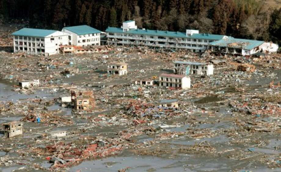 Urban area devastated by tsunami is seen in Rikuzentakata, Iwate, northern Japan Saturday, March 12, 2011 after Japan''s biggest recorded earthquake slammed into its eastern coast Friday. (AP Photo/Kyodo News) MANDATORY CREDIT, NO LICENSING ALLOWED IN CHINA, HONG KONG, JAPAN, SOUTH KOREA AND FRANCE