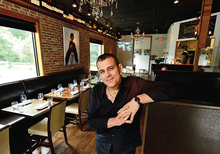 Matt Criscuolo recently opened his fourth restaurant in the area, Bistro 7, an upscale bistro with organic dishes. Hour photo / Erik Trautmann / (C)2012, The Hour Newspapers, all rights reserved