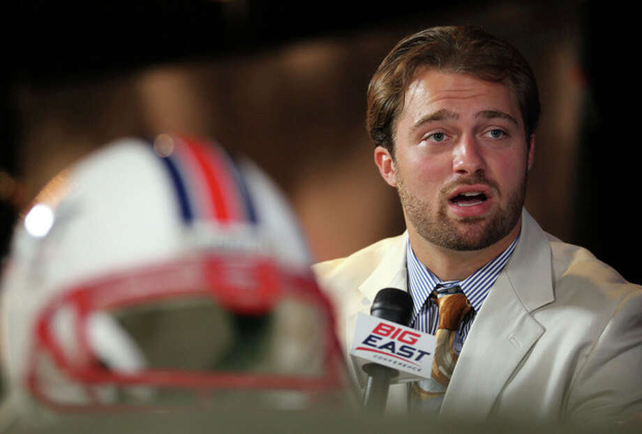 Temple quarterback Chris Coyer speaks with a television station during the Big East Conference NCAA college football media day, Tuesday, July 31, 2012, Newport, R.I. (AP Photo/Stew Milne) / FR56276 AP