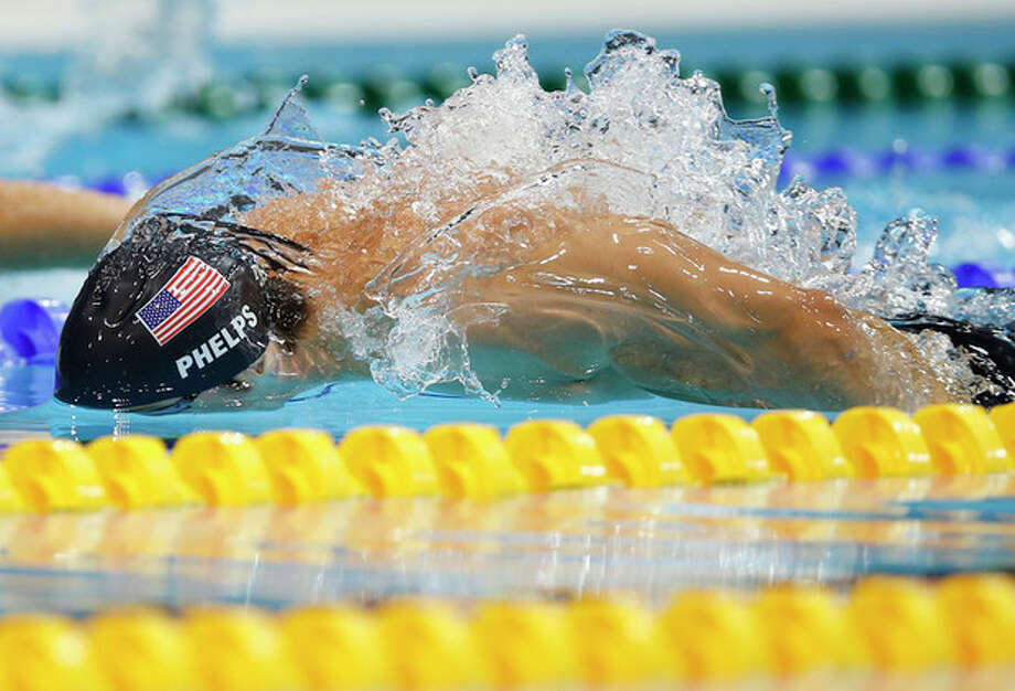United States' Michael Phelps competes in the men's 200-meter butterfly swimming final at the Aquatics Centre in the Olympic Park during the 2012 Summer Olympics in London, Tuesday, July 31, 2012. (AP Photo/Daniel Ochoa De Olza) / AP