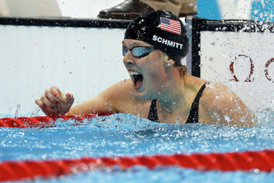 United States' Allison Schmitt reacts to her gold medal win in the women's 200-meter freestyle swimming final at the Aquatics Centre in the Olympic Park during the 2012 Summer Olympics in London, Tuesday, July 31, 2012. (AP Photo/Daniel Ochoa De Olza) / AP