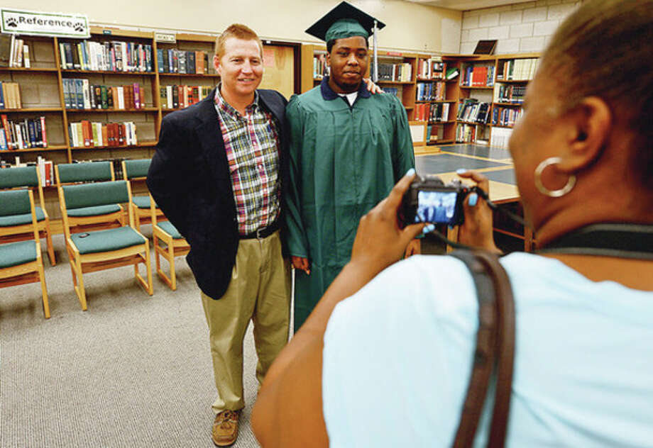 Norwalk High School graduates get photos taken with Direcotr of Summer programs, Dan Sullivan, during the graduation ceremony Tuesday morning at Norwalk High School for students from the summer school program.Hour photo / Erik Trautmann / (C)2012, The Hour Newspapers, all rights reserved