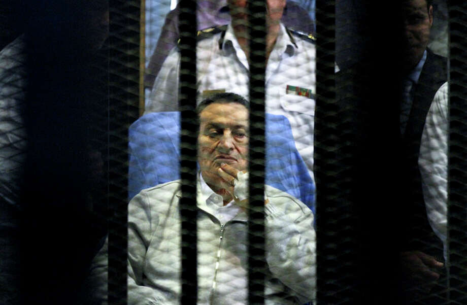 Egypt's deposed President Hosni Mubarak attends a hearing session in his retrial on appeal in Cairo, Egypt, Monday, April 15, 2013. Mubarak will remain in custody on new corruption charges despite a court order to release him on bail pending his retrial on charges related to killing of protesters in the 2011 uprising against him, Egypt's state news agency said Monday. (AP Photo/Ahmed Gomaa) / AP