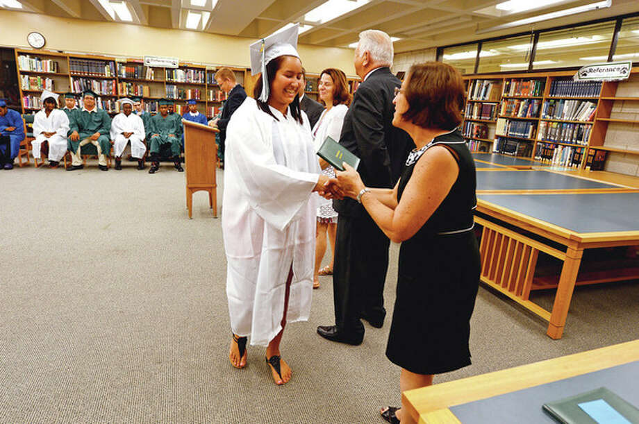 Hour photo / Erik TrautmannNorwalk High School graduate Ashley Arroya receives congratulations from Norwalk Superintendent of Schools Susan Marks during the graduation ceremony Tuesday morning at Norwalk High School for students from the summer school program. / (C)2012, The Hour Newspapers, all rights reserved