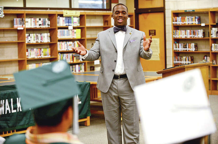 Former Norwalk High School student Kadeem Roberts was the keynote speaker during the graduation ceremony Tuesday morning at Norwalk High School for students from the summer school program.Hour photo / Erik Trautmann / (C)2012, The Hour Newspapers, all rights reserved