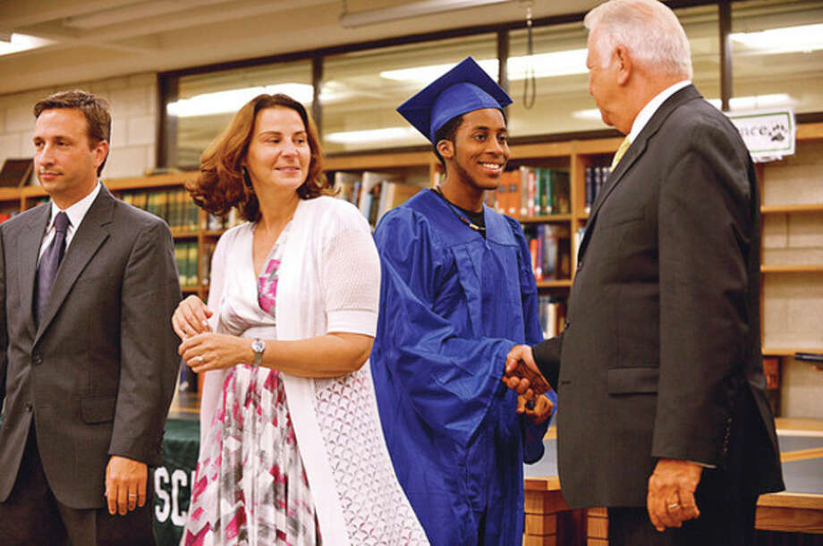 Brien McMahon High School graduates recieve congratulations from Norwalk mayor Richard Moccia during the graduation ceremony Tuesday morning at Norwalk High School for students from the summer school program.Hour photo / Erik Trautmann / (C)2012, The Hour Newspapers, all rights reserved