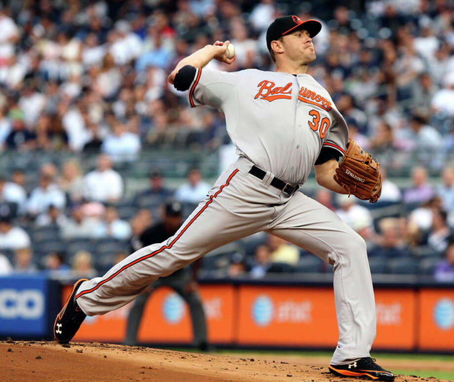 Baltimore Orioles' Chris Tillman pitches during the first inning of a baseball game against the New York Yankees, Tuesday, July 31, 2012, at Yankee Stadium in New York. (AP Photo/Seth Wenig) / AP