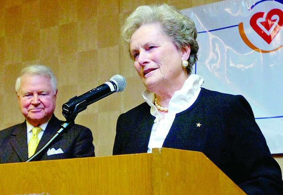 Distiguished Service Award recipients Carol and George Bauer make their acceptance remarks during the Voluntary Action Center''s 2011 Volunteer Leadership Breakfast Tuesday morning at Dolce Norwalk. Hour photo / Erik Trautmann