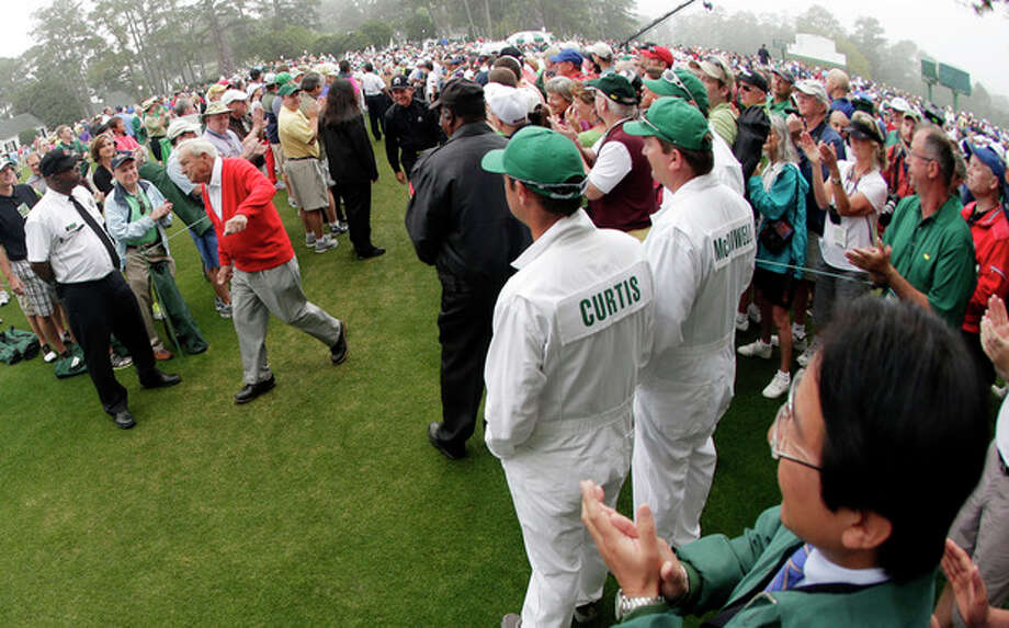 Honorary starter Arnold Palmer walks to the first tee before the first round of the Masters golf tournament Thursday, April 11, 2013, in Augusta, Ga. (AP Photo/Charlie Riedel) / AP