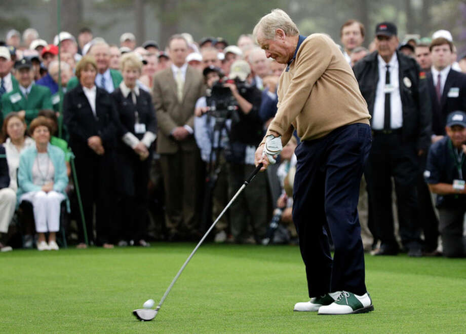 Honorary starter Jack Nicklaus hits a ball on the first tee before the first round of the Masters golf tournament Thursday, April 11, 2013, in Augusta, Ga. (AP Photo/David J. Phillip) / AP