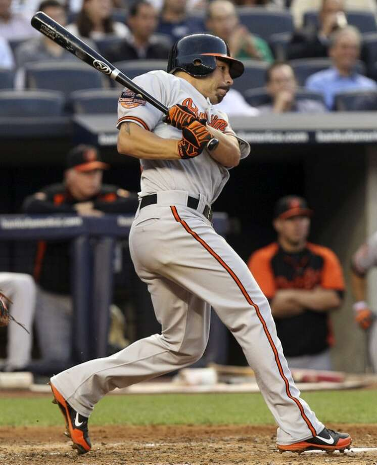 Baltimore Orioles' Omar Quintanilla hits a single to drive in two runs during the second inning of a baseball game against the New York Yankees, Tuesday, July 31, 2012, at Yankee Stadium in New York. (AP Photo/Seth Wenig)