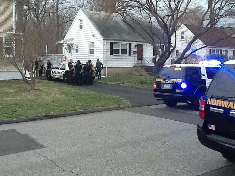 Norwalk Police detain two suspects at Ceder Crest address Wednesday.