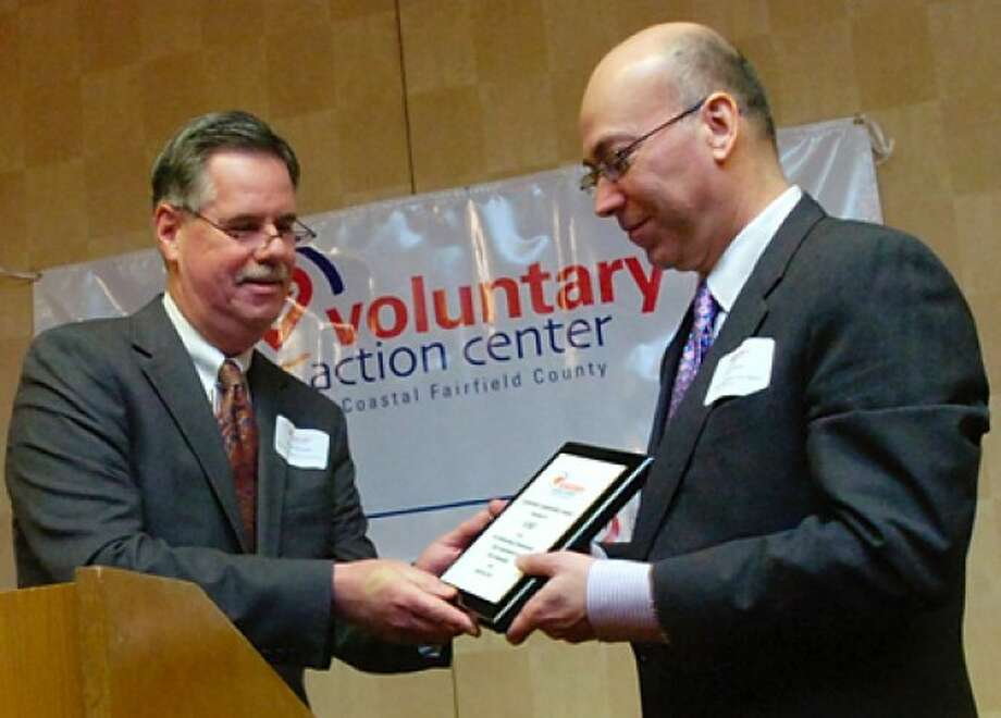 Greater Norwalk Chamber of Commerce president Ed Musante presents the Corporate Leadership Award to AT&T and AT&T Director of External Affairs, Harry Carey, during the Voluntary Action Center''s 2011 Volunteer Leadership Breakfast Tuesday morning at Dolce Norwalk. Hour photo / Erik Trautmann