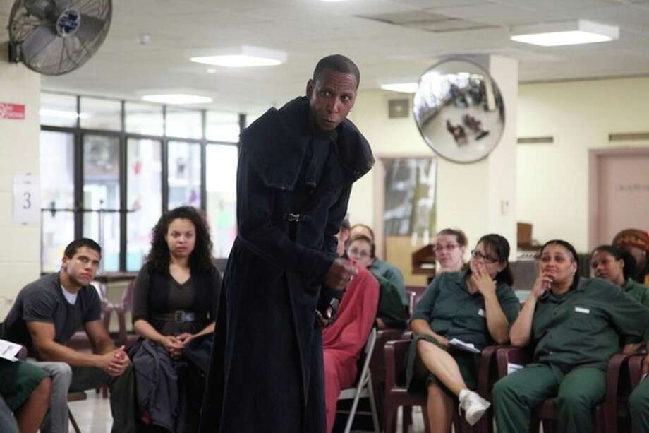 This Monday, July 30, 2012 photo shows actor Ron Cephas Jones playing Richard III in a performance of the Shakespeare play at the Taconic Correctional Facility in Bedford Hills, N.Y. The Public Theater's stripped down production, performed by a nine-member cast that play some 20 roles, has made more than 15 stops across the city, from a recreation center on Staten Island to a facility for homeless adults with mental illness in Manhattan. (AP Photo/Mark Kennedy) / AP