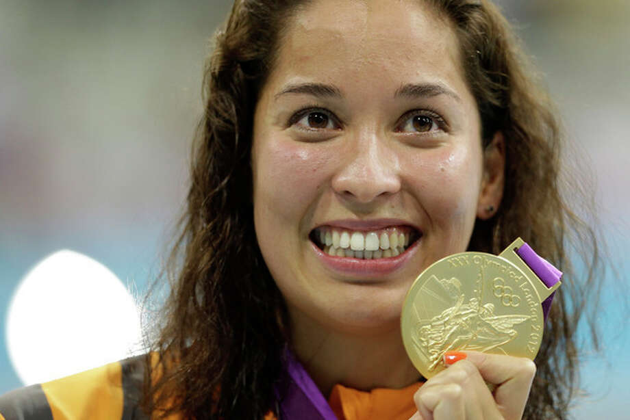 Netherlands' Ranomi Kromowidjojo poses with her gold medal for the women's 100-meter freestyle swimming final at the Aquatics Centre in the Olympic Park during the 2012 Summer Olympics in London, Thursday, Aug. 2, 2012. (AP Photo/Lee Jin-man) / AP