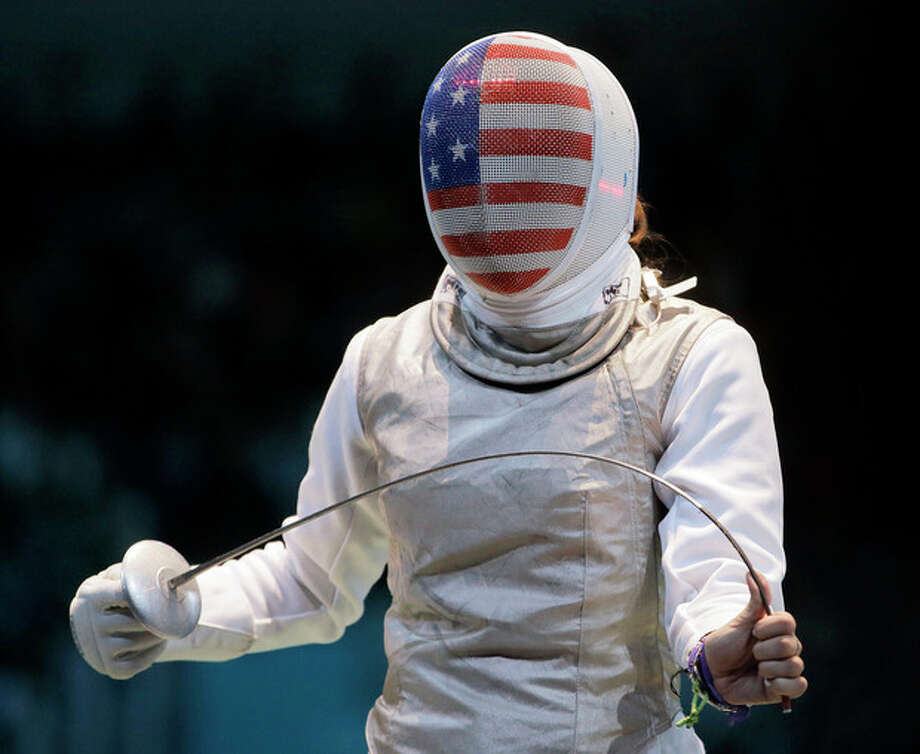 USA's Nicole Ross reacts during a quarterfinals match against South Korea's Jeon Hee-sook at women's team foil fencing at the 2012 Summer Olympics, Thursday, Aug. 2, 2012, in London. (AP Photo/Dmitry Lovetsky) / AP