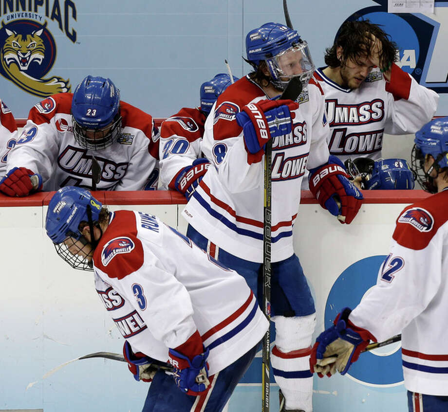 UMass Lowell players react to their 3-2 loss to Yale in overtime of an NCAA Frozen Four college hockey semifinal in Pittsburgh, Thursday, April 11, 2013. (AP Photo/Gene J. Puskar) / AP