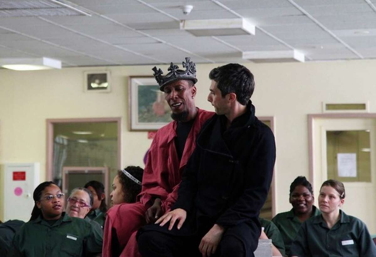 """This Monday, July 30, 2012 photo shows actors Ron Cephas Jones as Richard III, left, and Michael Crane, as Buckingham, performing Shakespeare's """"Richard III"""" at the Taconic Correctional Facility in Bedford Hills, N.Y. The medium-security prison was one stop The Public Theater's Mobile Shakespeare Unit has made across the city over the past several weeks. (AP Photo/Mark Kennedy)"""