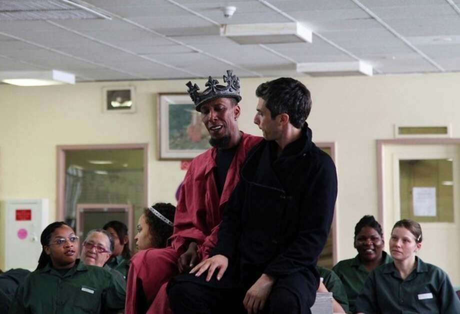 """This Monday, July 30, 2012 photo shows actors Ron Cephas Jones as Richard III, left, and Michael Crane, as Buckingham, performing Shakespeare's """"Richard III"""" at the Taconic Correctional Facility in Bedford Hills, N.Y. The medium-security prison was one stop The Public Theater's Mobile Shakespeare Unit has made across the city over the past several weeks. (AP Photo/Mark Kennedy) / AP"""