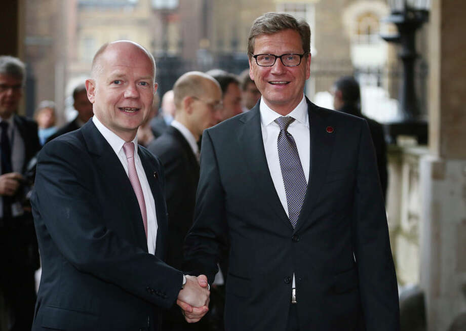 British foreign Secretary William Hague, right, greets German Foreign Minister Guido Westerwelle at the G8 Foreign Ministers meeting at Lancaster House Thursday April 11, 2013 in London, England. G8 Foreign Ministers are holding a two day meeting where they will discuss the situation in the Middle East, including Syria and Iran, security and stability across North and West Africa, Democratic People's Republic of Korea and climate change. British Foreign Secretary William Hague will also highlight five key policy priorities. (AP Photo / Peter Macdiarmid , pool / Getty Pool