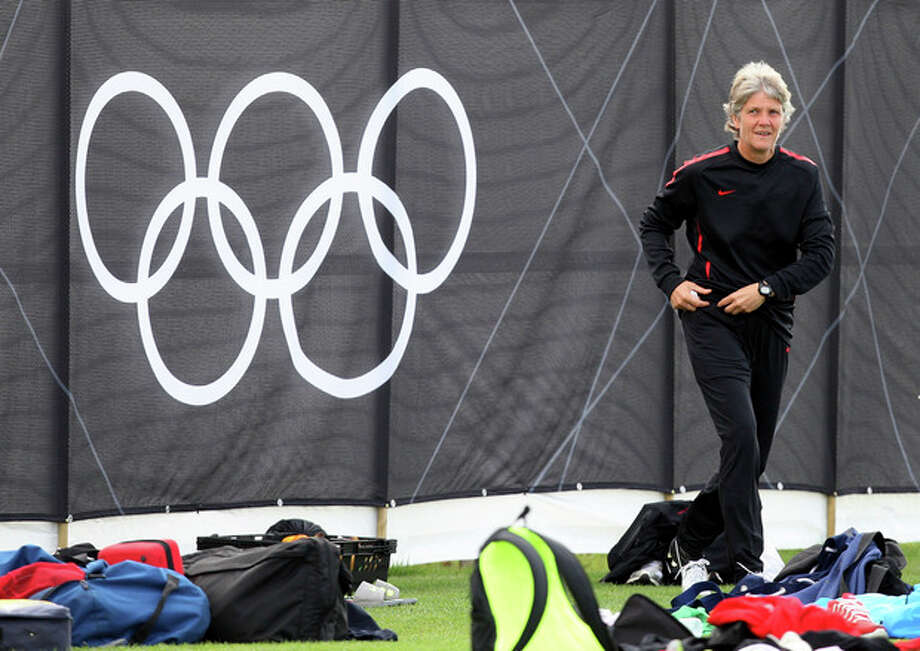 United States head coach Pia Sundhage of Sweden watches during soccer practice for the 2012 London Summer Olympics at Cochrane Park in Newcastle, England, on Thursday, Aug. 2, 2012. The United States will face New Zealand in the women's quarter final soccer match on Friday. (AP Photo/Scott Heppell) / AP