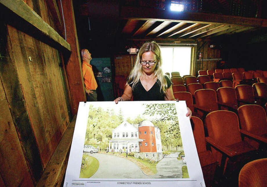 Hour photo / Erik TrautmannCo-head of Connecticut Friends School, Kim Tsocanos, talks about the school's plans to renovate the White Barn theater at its Norwalk campus. / ©2012 The Hour Newspapers