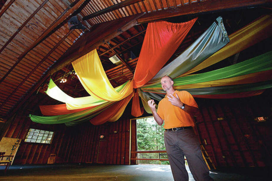Co-head of Connecticut Friends School, Mark Dansereau, talk about their plans to renovate the White Barn theater at their Norwalk campus Wednesday.Hour / Erik Trautmann / ©2012 The Hour Newspapers