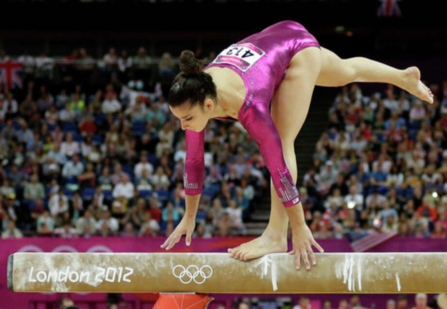 U.S. gymnast Alexandra Raisman loses her balance as she performs on the beam during the artistic gymnastics women's individual all-around competition at the 2012 Summer Olympics, Thursday, Aug. 2, 2012, in London. (AP Photo/Gregory Bull) / AP