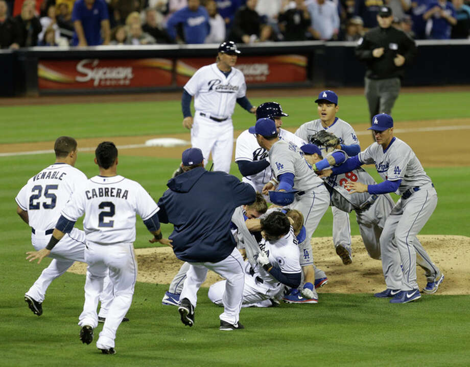San Diego Padres' Carlos Quentin and teammates battle the Los Angeles Dodgers after Quentin was hit by a pitch thrown by Dodgers pitcher Zack Greinke in the sixth inning of baseball game in San Diego, Thursday, April 11, 2013. (AP Photo/Lenny Ignelzi) / AP