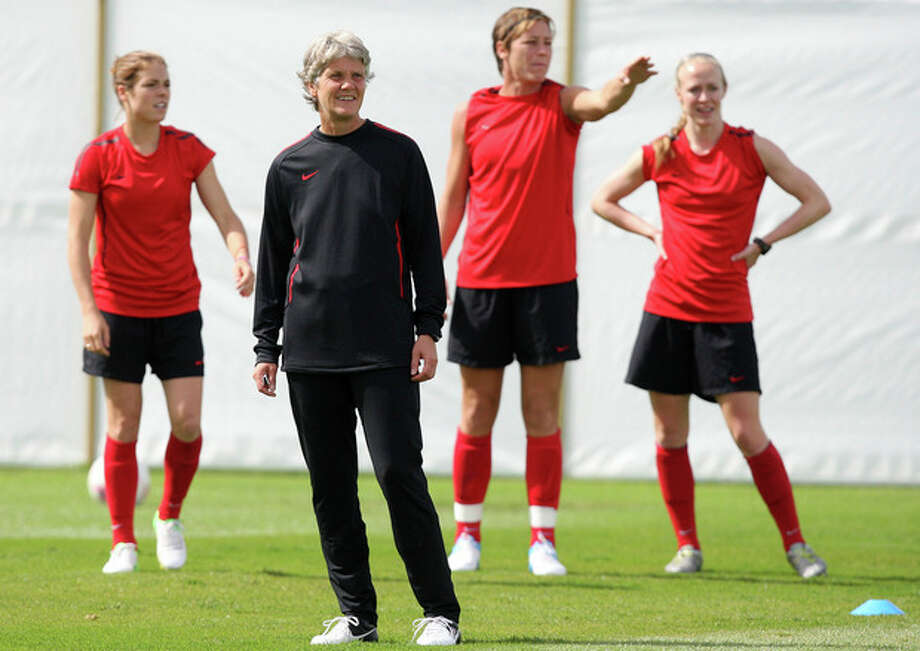 United States head coach Pia Sundhage of Sweden, center, trains with her players during soccer practice for the 2012 London Summer Olympics at Cochrane Park in Newcastle, England, on Thursday, Aug. 2, 2012. The United States will face New Zealand in the women's quarter final soccer match on Friday. (AP Photo/Scott Heppell) / AP