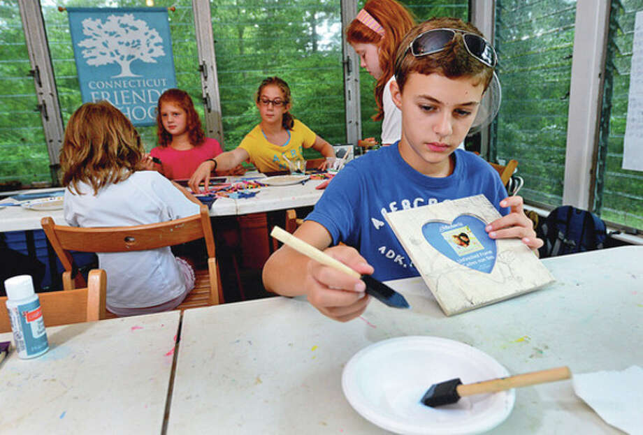 Tino Guarino, 11, paints during art time at Connecticut Friends School at their White Barn Campus in Norwalk Wednesday.Hour / Erik Trautmann / ©2012 The Hour Newspapers