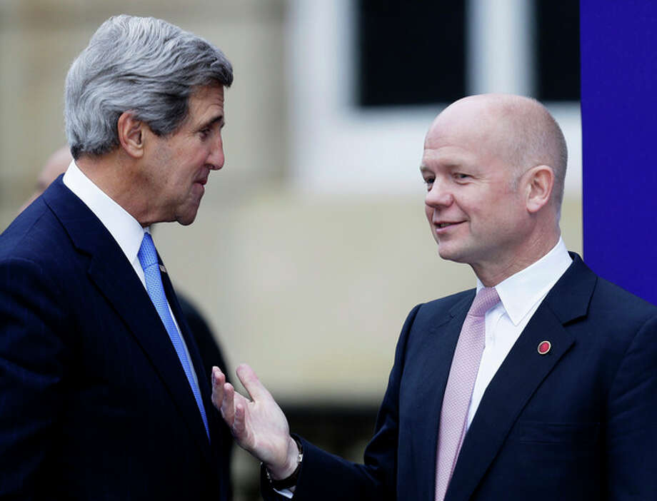U.S. Secretary of State John Kerry, left, chats with Britain's Foreign Secretary William Hague upon arrival for the start of a G8 Foreign Ministers meeting in London, Thursday, April, 11, 2013. (AP Photo/Alastair Grant) / AP