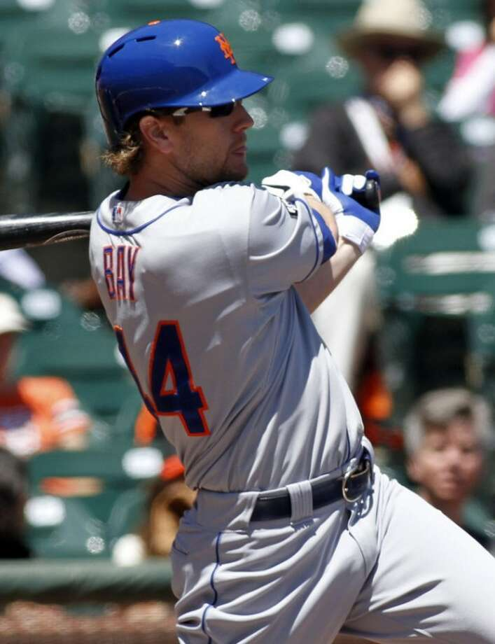 New York Mets' Jason Bay hits a two-RBI single against the San Francisco Giants during the first inning of a baseball game, Thursday, Aug. 2, 2012, in San Francisco. (AP Photo/George Nikitin)