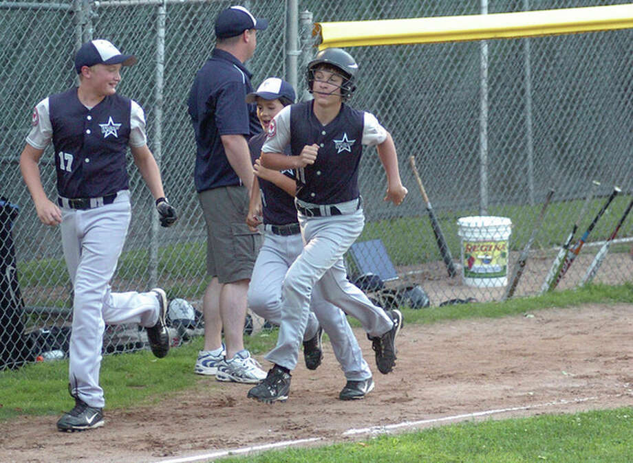Hour photo/Matthew Vinci WestportÕs Mack Muller rounds third after hitting a three-run home run during MondayÕs District 2 Little League tournament action against Fairfield American. Fairfield won, 12-6. Westport will face elimination in a second-round game tonight. / (C)2011, The Hour Newspapers, all rights reserved