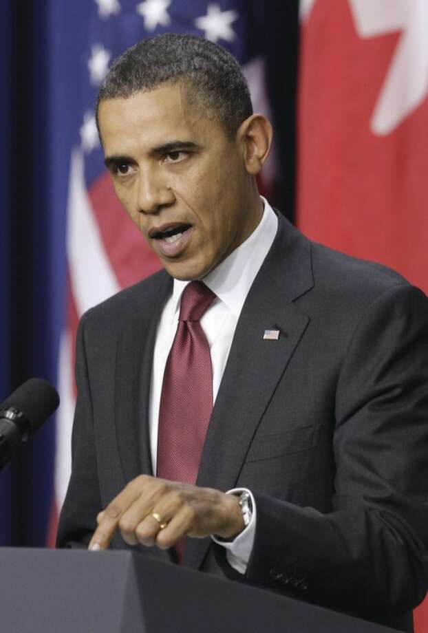 President Barack Obama talks about the situation in Egypt during a joint news conference with Canada's Prime Minister Stephen Harper, Friday, Feb. 4, 2011, in the Eisenhower Executive Office Building on the White House complex in Washington. (AP Photo/Charles Dharapak)