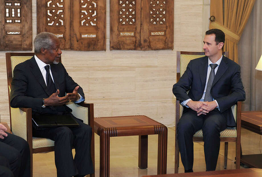 FILE - In this March 10, 2012 file photo released by the Syrian official news agency SANA, President Bashar Assad, right, meets with Kofi Annan, the United Nations special envoy to Syria, in Damascus, Syria. On Thursday, Aug. 2, 2012, Annan said he is quitting as special envoy to Syria, effective Aug. 31. (AP Photo/SANA, File) / SANA