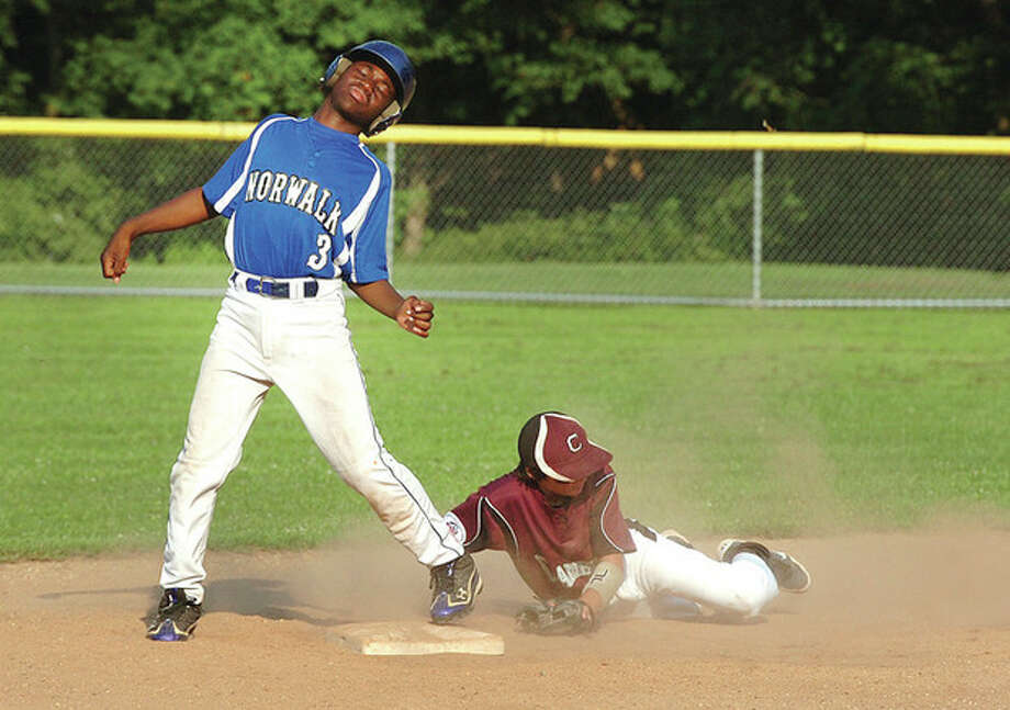 Hour photo/Alex von KleydorffCal Ripken's Jordan O'Brien is safe at second as Ed McCabe of Cranbury arrives late with the tag during Thursday night's Kinlock Tournament game. Ripken rolled to a 9-5 victory / 2012 The Hour Newspapers