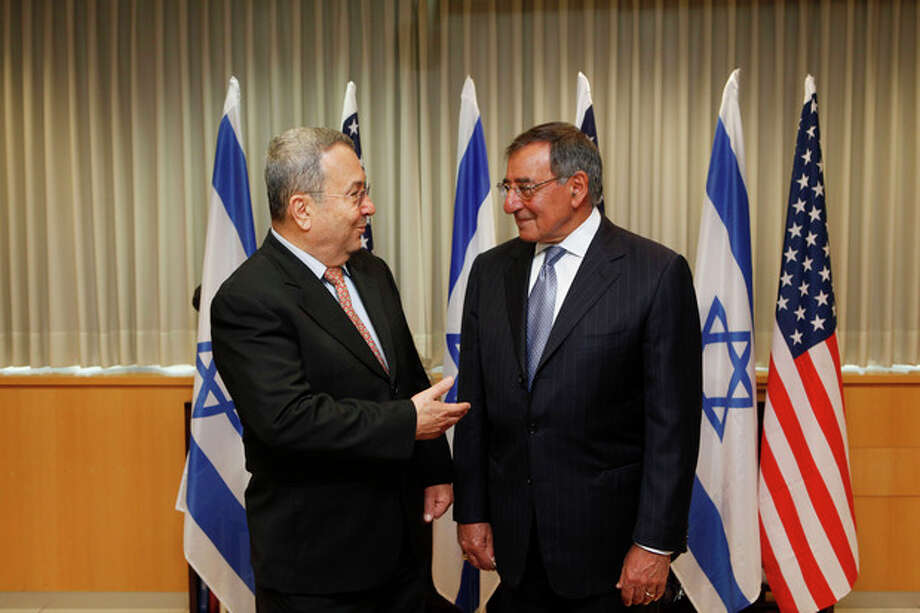 Israeli Defense minister Ehud Barak, left, and U.S. Defense Secretary Leon Panetta meet in Tel Aviv, Israel, Wednesday, Aug. 1, 2012. Israel's threats to attack Iran and the violence convulsing Syria top the agenda of Panetta's meetings Wednesday with Israeli government leaders. (AP Photo/Gali Tibbon, Pool) / AFP POOL