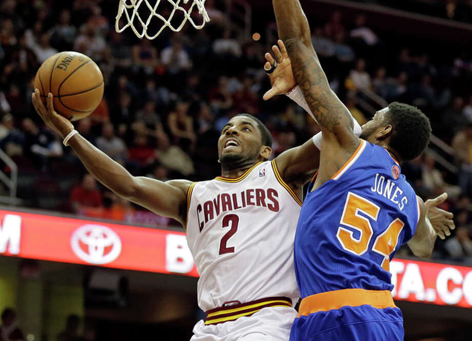 Cleveland Cavaliers' Kyrie Irving (2) shoots against New York Knicks' Solomon Jones in the first quarter of an NBA basketball game on Friday, April 12, 2013, in Cleveland. (AP Photo/Mark Duncan) / AP