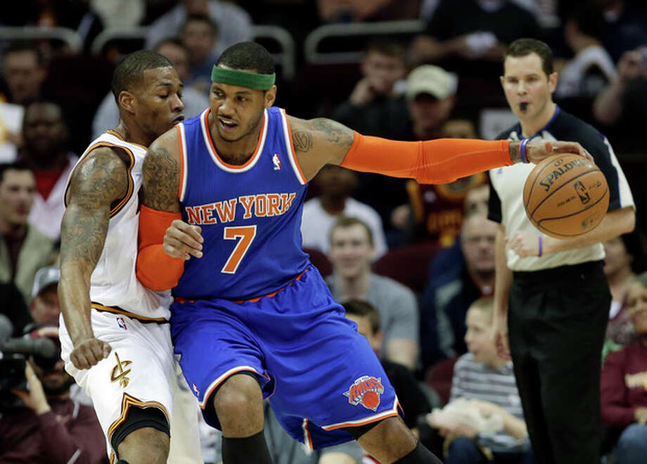 New York Knicks' Carmelo Anthony (7) backs in on Cleveland Cavaliers' Alonzo Gee in the first quarter of an NBA basketball game on Friday, April 12, 2013, in Cleveland. (AP Photo/Mark Duncan) / AP
