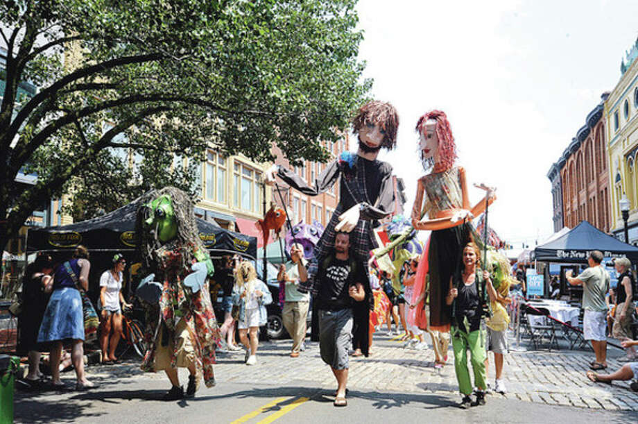 The 2011 SONO Arts Festival puppet parade on Washington Street. hour photo/matthew vinci / (C)2011, The Hour Newspapers, all rights reserved